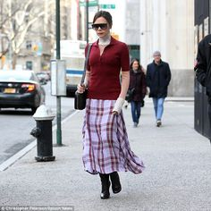 Walk this way: Victoria Beckham wrapped up against the cold in an ultra chic polo shirt and maxi-skirt as she headed out for son Brooklyn's birthday in New York on Saturday