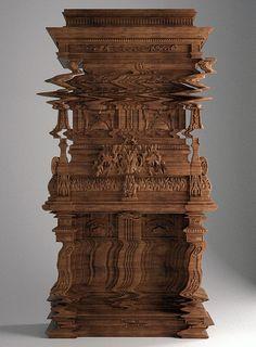 Carved wooden cabinet by Ferruccio Laviani looks like a digital glitch