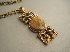 Pentti Sarpaneva for Turun Hopea (FI), vintage modernist bronze necklace with tiger's eye gemstone, 1970s. #finland   finlandjewelry.com