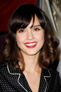 Sin City starlet Jessica Alba works a chic long bob and rich brunette hue with added side-swept #Bangs for a Hollywood finish.