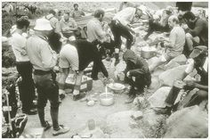 Feeding moments; RAF Mulkila expedition walk-in, Indian Himalayas, 1975. In here Tom MacDonald (extreme left), Norman Ridley, Nev Taylor, Danny Daniels, Clive Brooks, Roy ? [other names to be added]