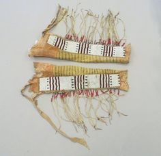 Blackfoot, Piegan (Native American). <em>Pair of Chief's Fringed Dress Leggings</em>, early 19th century. Hide, beads, red cloth binding,ermine fur, pigment wood Brooklyn Museum, Henry L. Batterman Fund and Frank Sherman Benson Fund, 50.67.5b-c. Creative Commons-BY (Photo: Brooklyn Museum, CUR.50.67.5b-c_view1.jpg)