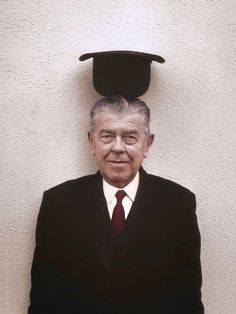 Belgian surrealist artist René Magritte, 1965.  Photo by Duane Michals, colorized by painters-in-color