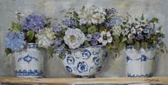Mixture of flowers in blue and white pots