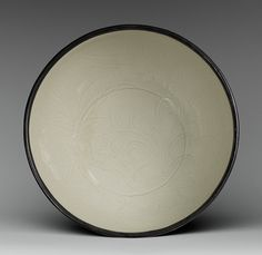 Basin, Northern Song dynasty (960–1127), 11th–12th century; Ding ware  Probably from the Jianci village kilns, Hebei Province, China  Porcelain
