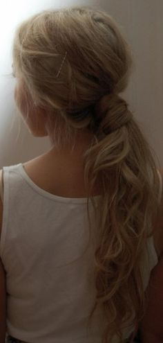 Hair pulled back in ponytail, with small section of ponytail wrapped around elastic!