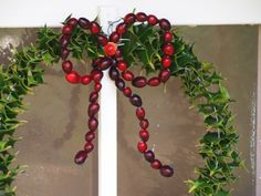 Christmas wreath with a bow of red cranberries