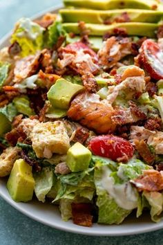 A salad so flavorful and satisfying you'll forget it all started with lettuce. The combination of salmon, bacon, and avocado is unbelievable and the homemade creamy dressing completes the whole dish!
