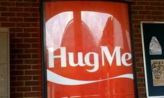 Give us a hug: The Coca-Cola vending machine that asks for hugs, not money, in return for a can of Coke