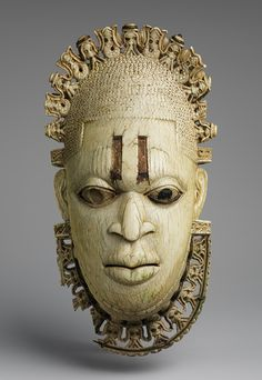 Queen Mother Pendant Mask: Iyoba, 16th century  Nigeria; Edo peoples, court of Benin  Ivory, iron, copper (?)