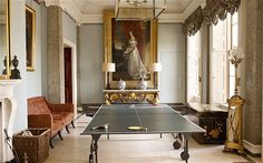 Goodwood House -- Lord and Lady March commissioned a new entrance hall from the architect Christopher Smallwood, which is dominated by a ping-pong table and a handsome full-length portrait by Thomas Lawrence Picture: SIMON UPTON