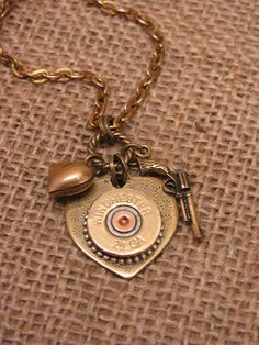 Items similar to Bullet Jewelry - Shotgun Casing Jewelry - Shot Thru the Heart Necklace - BEST SELLER! - 28 Gauge Heart and Pistol Charm Necklace on Etsy Shotgun Shell Art, Shotgun Shell Crafts, Shotgun Shell Jewelry, Shotgun Shells, Bullet Shell Jewelry, Bullet Casing Jewelry, Bullet Earrings, Ammo Jewelry, Jewelery