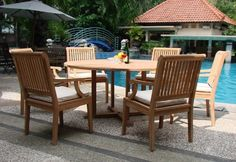 "Grade-A Teak Wood Luxurious Dining Set Collections (SK1): 7 pc - 60"" Round Table And 6 Arm / Captain Chairs [**Click To See More Choices...] by TeakStation. $1399.99. Round table has a 2"" Umbrella hole in the middle of the table.. Table comes with 2"" umbrella hole. Dimension: 60"" Round Table, 30.5"" H. Chair Dimension: 21.5"" Width x 23.5"" Depth x 35-1/2"" Height. 7pc Set includes: 60"" Round Table and 6 Arm Chairs. ADD SUNBRELLA FABRIC CUSHIONS BY SEARCHING ""Teakstation ..."