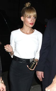 Black pencil skirt, white blouse, black clutch and high bun + Red lips.