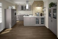 hanpainted grey shaker kitchen with stone feature wall