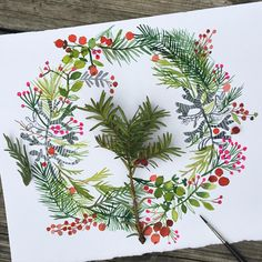 Watercolor Christmas wreath, painted in classic red and green colors with holly berries, pine boughs and a variety of leaves & sprigs. Holiday art.