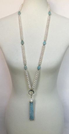 This stunning white pearl, aquamarine, and blue topaz necklace and tassel is accented with white gold faceted beads. The 38 inch sautoir is extremely versatile with a removable tassel and mother of pearl ring. Each strand sparkles with faceted Bead Jewellery, Jewelry Making Beads, Pearl Jewelry, Bridal Jewelry, Beaded Jewelry, Beaded Necklace, Beaded Bracelets, Pearl Ring, Jewelry Patterns