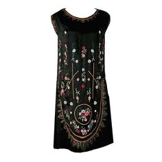 1920's French Heavily-Embroidered Metallic Floral Silk Drop-Waist Flapper Dress   From a collection of rare vintage evening dresses at https://www.1stdibs.com/fashion/clothing/evening-dresses/
