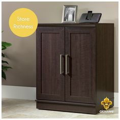 Add richness to your home decor with this perfectly sized wooden storage cabinet in the dark walnut finish from Giovanni. Visit giovanniboutique.com and get custom crafted luxury furniture at your doorstep. #BoutiqueFurniture #CustomCrafted #HomeDecor #Furniture #ModernHome #LuxuryFurniture #WoodenFurniture #Storage #Cabinet