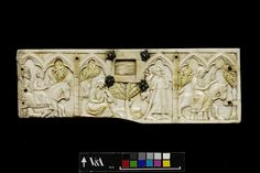 Hunting scenes. Made in Paris, France 1320-1330. Carved ivory. A.37-1923. This ivory panel, made in the middle of 14th century in Paris, is from the front of a casket. To the right a woman with a branch in her hand rides on horseback, followed by a servant carrying a hare on a pole. Behind him are a seated woman with a falcon and a man on horseback holding a falcon, accompanied by a servant and a dog. In the centre is the lock hole with four silver nuts in the shape of fleurs-de-lys