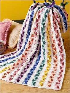 """Plaited Scraps Afghan - $  Size: 39"""" x 62"""". Crocheted using worsted yarn.  Skill Level: Beginner"""