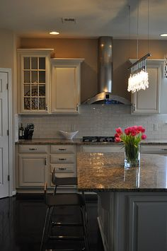 JWS Interiors - kitchens - white kitchen with light granite, Italian subway tiles, espresso colored floors, linear crystal chandelier, Affordable Kitchen Redo, Kitchen Remodel, Kitchen Dining, Kitchen Cabinets, Dining Rooms, Kitchen Ideas, Beach House Kitchens, Home Kitchens, Kitchen Hoods