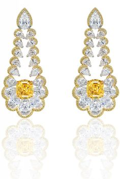 Stunning yellow gold earrings set with yellow diamonds