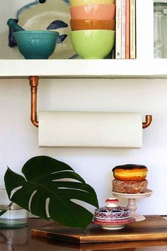 And use a copper pipe as a paper towel holder.
