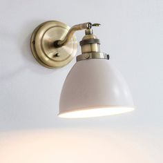 Retro style vintage wall light finished in Antique Brass with a satin taupe shade Features and adjustable knuckle and on/off switch Lamps not Industrial Wall Lights, Vintage Wall Lights, Vintage Walls, Industrial Style, Hallway Lighting, Bedroom Lighting, Stone Colour Paint, Globe Lights, Desk Lamp