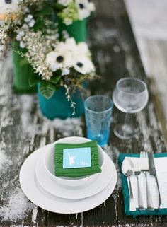 wintery teal and green tablescape...absolutely adore this! Great part about this tablescape is by using the vibrant colors in the decor, you can save money on the flowers. Use white flowers with various greenery from your backyard!