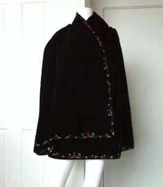I made this beautiful wrap back in the 80s. It is made of black silk velvet and the lining is black silk satin. The border is ribbon embroidered featuring the sturt pea with black seed beads in the centre and a yellow and green (wattle) floral design. It is definitely a statement piece and perfect day or evening. The wrap measures 196 cm in length and 88 cm in width. I have lovingly stored and cared for this wrap and there are no flaws visible to me. Please convo me for more images or…