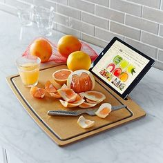 This cutting board with a tablet stand ($75)   31 Insanely Clever Products Dads Didn't Know They Needed