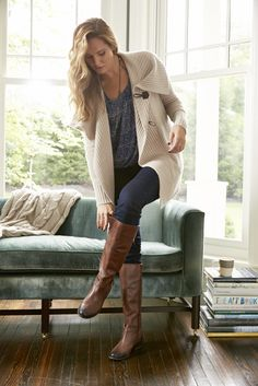 Two of our fall staples: oversized, cozy sweaters and tall, riding boots.