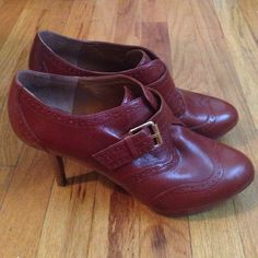 Nine West Oxford Wingtip Heels Nine West Oxford Wingtip Heels. Reddish brown coloration with gold tone buckle. Very little wear. Some very small flaws as shown in last image. Size 9M. Nine West Shoes Heels