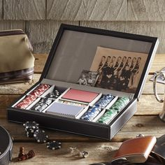 Dealer's Poker Set | With two hundred clay chips, two regulation decks, and five dice, this black leather case contains all the essentials for a night of casino-style gaming.