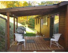"""From this beautiful home, I would take this back porch. I love the sliding glass doors and the grill in the back really gives it that """"outdoor cookout"""" feel. My family really wants to buy a home where we can throw amazing outdoor parties!  -Claysville PA"""