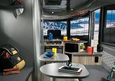 Airstream have introduced the Basecamp, a compact and rugged travel trailer which combines the brand´s classic aluminum-sided look with ultra-flexible interior accommodations. The Airstream Basecamp Trailer features a rounded polished aluminum coachw