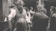 Daniel Huttlestone gets a hug from Hugh Jackman while Aaron Tveit smiles winningly from the side. (GIF)