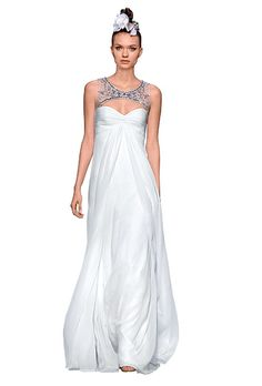 Brides.com: Jeweled Necklines. A beaded keyhole neckline gives this silk-chiffon gown a shimmery, subtly sexy vibe.  Gown, $4,500, Monique Lhuillier