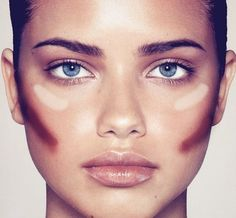 """Create the illusion of thinner cheeks by applying your contour shade in a diagonal line from the center of your cheek to the ear. Make a slight """"fish face"""" while you do this to figure out the perfect placement, and don't forget to blend. The higher you place your contour shade, the sharper your cheekbones will look. Swipe highlighter across the tops of the cheekbones to really bring out the contour. via StyleList"""