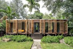 Florida-based studio Brillhart Architecture has completed a home fronted by slatted wooden shutters in a lush Miami forest. The house, named Brillhart Residence, was designed by husband-and-wife du. Architecture Durable, Tropical Architecture, Vernacular Architecture, Residential Architecture, Architecture Design, Chinese Architecture, Architecture Office, Futuristic Architecture, Natural Architecture
