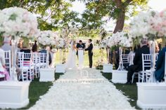 white and blush garden wedding with archway and tall centerpieces lining the aisle.   vendors : Blush Botanicals, Couture Events, Bryan Miller Photography, Inn at Rancho Santa Fe
