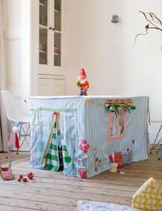 A DIY tent for the little ones:) Made with an old dining table. Just need some little fabric, needle, and thread....