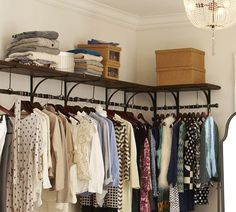 """Love love LOVE these closet """"rods"""" for lack of a better word. You didn't get to shove all your clothes over to one side, but my oh my does it look nice!"""