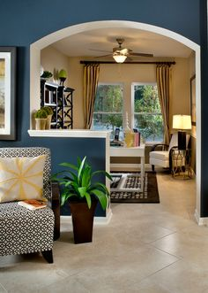 Dark Blue, black, white and next room in gold toned neutrals - David Weekley Homes