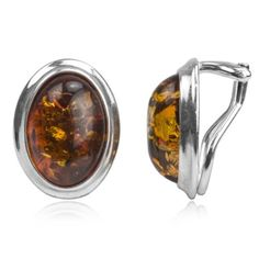 Sterling Silver Amber Oval Clip Earrings. Amber is organic material with healing properties Weight of amber is traditionally calculated in grams, not carats like precious gemstones. Market value of amber is approximately the same as silver and price for finished piece of jewelry calculated by total weight of the product. Earrings measurements Length 0.6 Inch Width 1/2 inch Weight 4.3 grams. Sterling silver. Clip earrings.