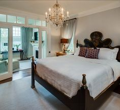 Master bedroom. French doors into setting area.