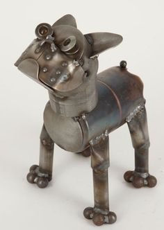 Metal Boston Terrier Dog Sculpture Statue Full of rustic charm and a sense of fun, each Junkyard Dog and Cat sculpture captures the humorous creative vision of Kentucky artist, Richard Kolb. Each creation is hammered, sculpted and welded by hand, utilizing all types of recycled parts, such as bike chains for tails, oil cans for bodies or colorful marbles for eyes. No two are exactly alike. You will have a lot of fun identifying the types of parts used in each work of art.