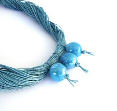 Blue linen necklace with ceramic balls spring by Deconfetti,