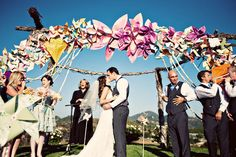 Windmills and kites are a great addition to the decor for a carnival wedding #carnival #wedding